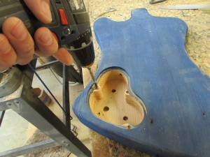 "Drilling 1/4"" holes"